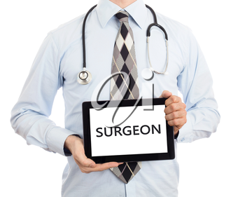 Doctor, isolated on white backgroun,  holding digital tablet - Surgeon