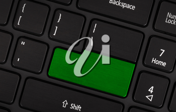 Laptop computer keyboard with blank green button for text