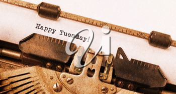 Vintage typewriter close-up - Happy Tuesday, concept of motivation