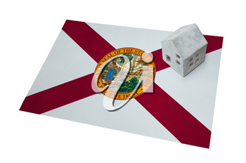 Small house on a flag - Living or migrating to Florida