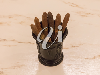 Collection of different cigars in a cup - Selective focus