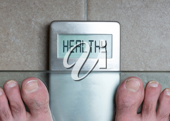 Closeup of man's feet on weight scale - Healthy