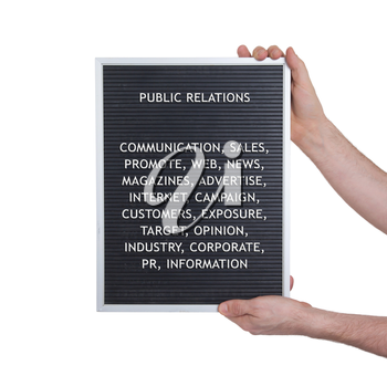 Public relations concept in plastic letters on very old menu board, vintage look