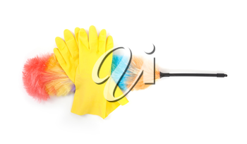 Yellow cleaning gloves with a duster - isolated on white