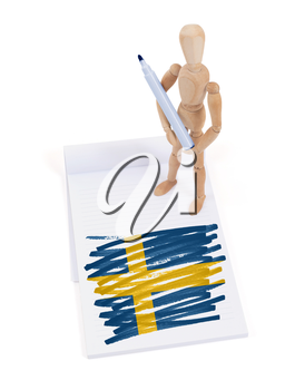 Wooden mannequin made a drawing of a flag - Sweden
