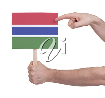 Hand holding small card, isolated on white - Flag of Gambia