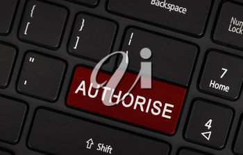 Laptop computer keyboard enter button with text authorise