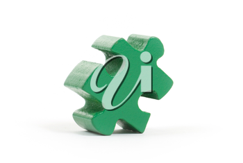 Closeup of big green jigsaw puzzle piece isolated on white