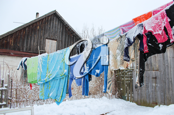 the image of washing suspended on a cord in winter