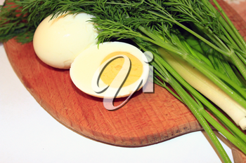 sliced boiled egg, green onions and fresh dill