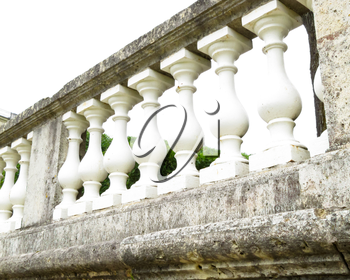 palace of white stone railing against a gray sky