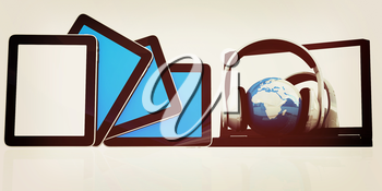 headphones and  earth on the  laptop and tablet pc on a white background. 3D illustration. Vintage style.