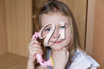 Portrait of beautiful girl with pink telephone