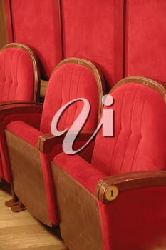 Background of many red theatrical red chairs