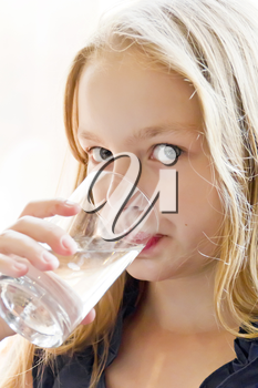 Portrait of Caucasian girl with white hair drinking water