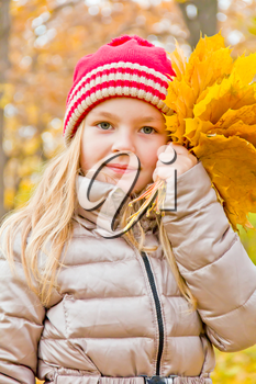 Photo of cute smiling girl in autumn
