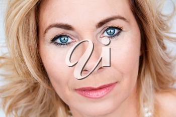 Horizontal portrait of adult blond woman with makeup