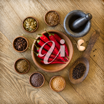 Spices in wooden bowls and mortar with pestle