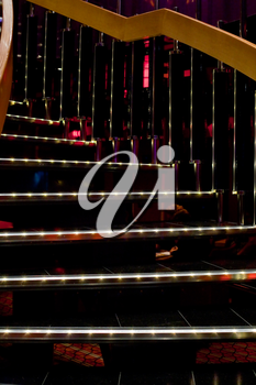illuminated spiral stairs in disco club on cruise liner