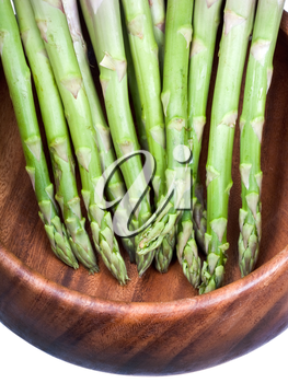 green asparagus in wooden bowl