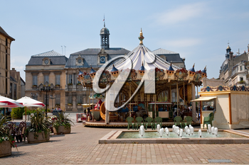 Traditional merry-go-round on town square, France