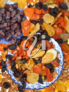 top view of sweet dried fruits on asian plates