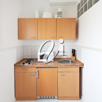 simple kitchen with furniture set and kitchen equipment