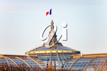 french state flag on Great Palace in Paris in evening