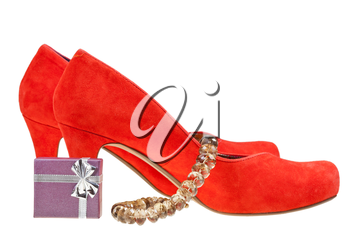 pairs of red high heel pumps with small gift box and necklace isolated on white background