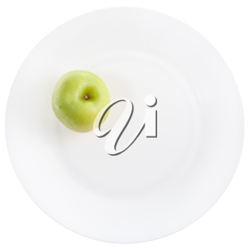 yellow green apple on white plate isolated on white background