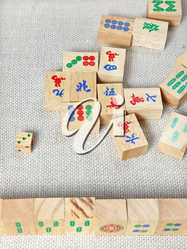 top view of wooden tiles of mahjong desk game on textile table