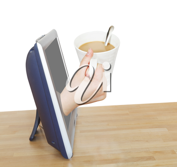 hand holding cup of coffee with milk leans out TV screen isolated on white background