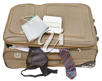 sphygmometer on suitcase with male tie and female bra isolated on white background