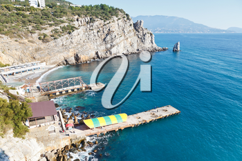 view of Parus (Sail) Rock and beach with Swallow's Nest castle on Southern Coast of Crimea