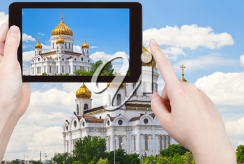 travel concept - tourist taking photo of Cathedral of Christ the Saviour, Moscow on mobile gadget, Russia