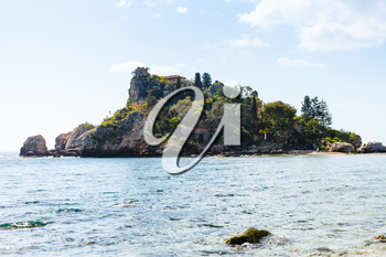 TAORMINA, ITALY - APRIL 3, 2015: island Isola Bella in Ionian Sea, Sicily, Italy. Also known as The Pearl of the Ionian Sea in 1990 the island being turned into nature reserve, administrated by WWF