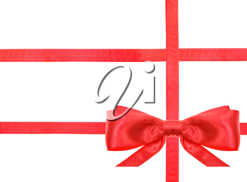 one red satin bow in lower right corner and three intersecting ribbons isolated on horizontal white background