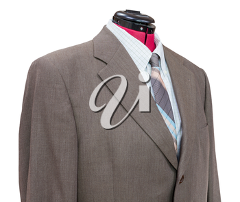 business suit on tailor mannequin - brown woolen jacket with shirt and tie close up isolated on white background