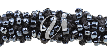 beadwork - many black glass beads sewn on necklace close up isolated on white background