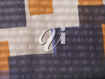 textile background - silk fabric with geometric pattern with crape jacquard weave pattern of threads close up