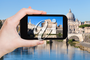 travel concept - tourist photographs Castel Sant Angelo (Holy Angel Casle) in Rome city on smartphone in Italy