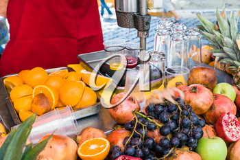 open stall with fresh fruits for preparing natural juice on street in Istanbul city