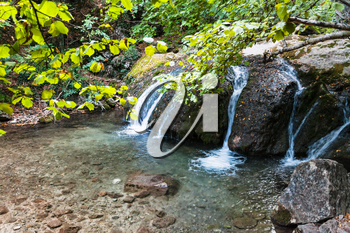travel to Crimea - water flow of Ulu-Uzen river in Haphal Gorge of Habhal Hydrological Reserve natural park in Crimean Mountains in september
