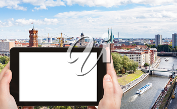 travel concept - tourist photographs Spree River with Rathausbrucke in Berlin city in Germany in september on tablet with cut out screen for advertising logo