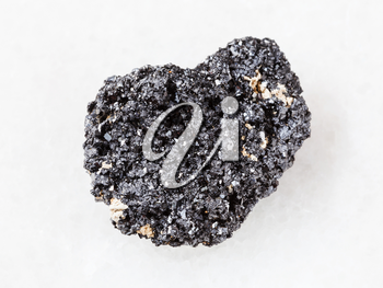 macro shooting of natural mineral rock specimen - crystalline Perovskite stone on white marble background