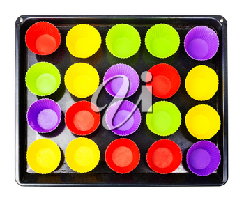 top view of tray with many empty multicolor silicone molds for cupcakes isolated on white background
