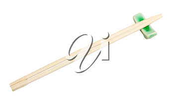 disposable wooden chopsticks served on chopstick rest isolated on white background