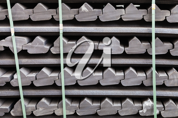 construction background - stockpile of gray rubber retainers for rails of tram track