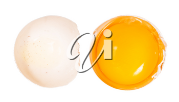 top view of separated egg yolk in shell and empty half of shell isolated on white background