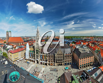 Aerial fish eye view of Munich -  Marienplatz, Neues Rathaus and Frauenkirche from St. Peter's church. Munich, Germany